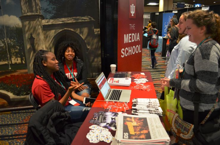 Students chat about Indiana University with college advisers at the JEA/NSPA trade show.