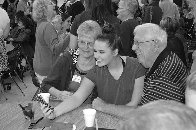 COOKIES, PUNCH, AND SELFIES: Class of 2016 graduate Kalyn Figiliuo takes a picture with her grandparents during the reception at the 2015 Grandparents day, which took place on Oct. 23, 2015.