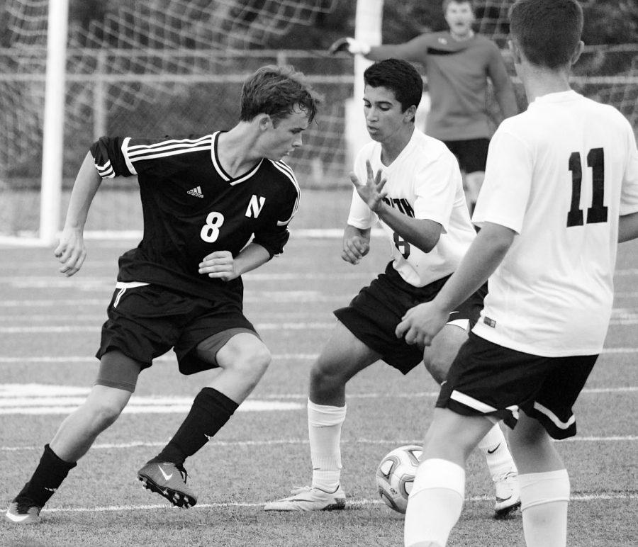 ON THE ATTACK: Jack Richards (11) faces off against a Hinsdale South player as he goes to steal the ball.