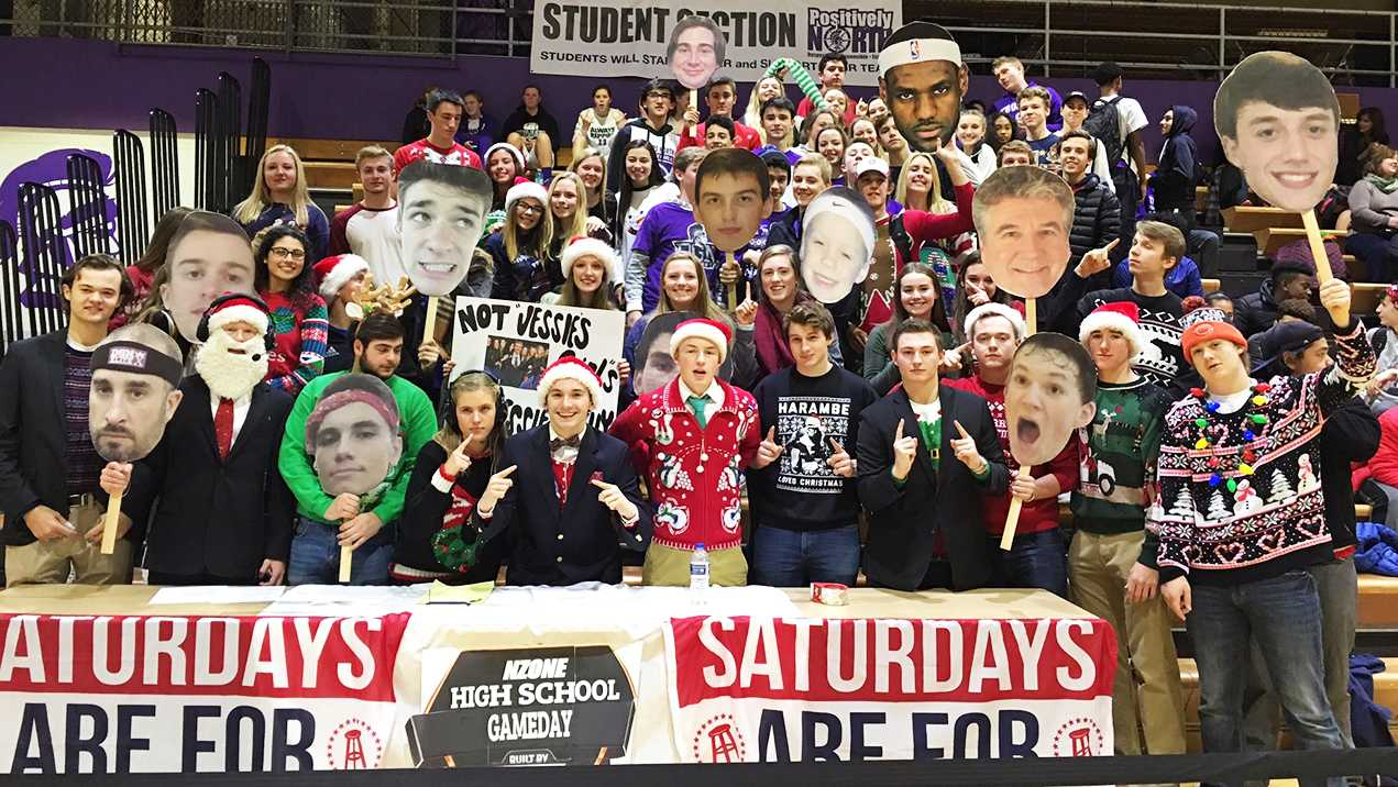 HITTING THE COURTS: Students, led by N-Zone, cheer in Christmas apparel to help support the boys' varsity basketball team to victory against DGS on Dec. 17.