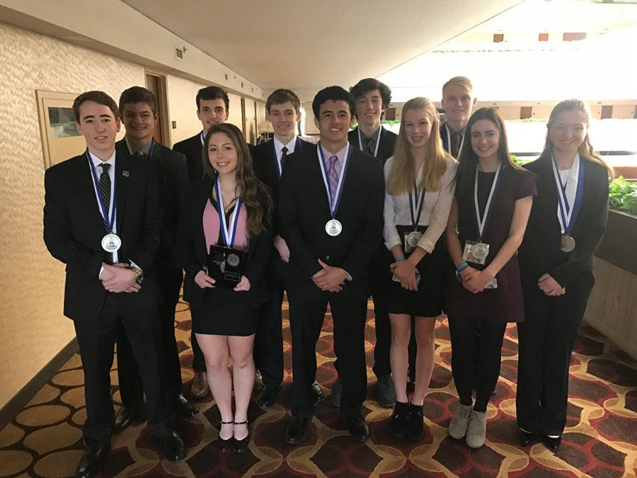 THE BUSINESS OF GOING TO STATE: DECA state qualifiers show off their medals.