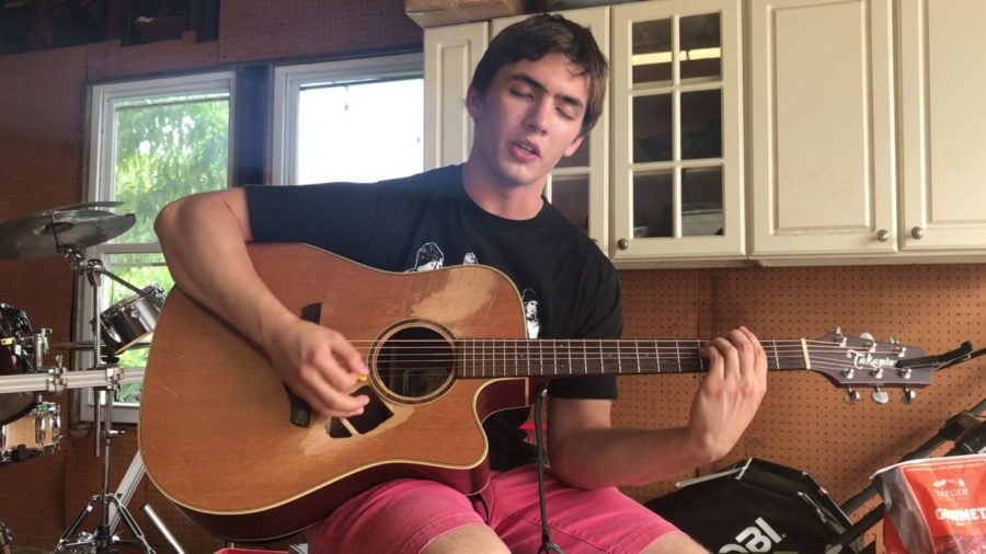 Strumming a Tune: Fredo Fosco (12) plays a song for his YouTube audience. Performing under the moniker Fredo Disco, Fosco has amassed over 2,000 subscribers on YouTube.