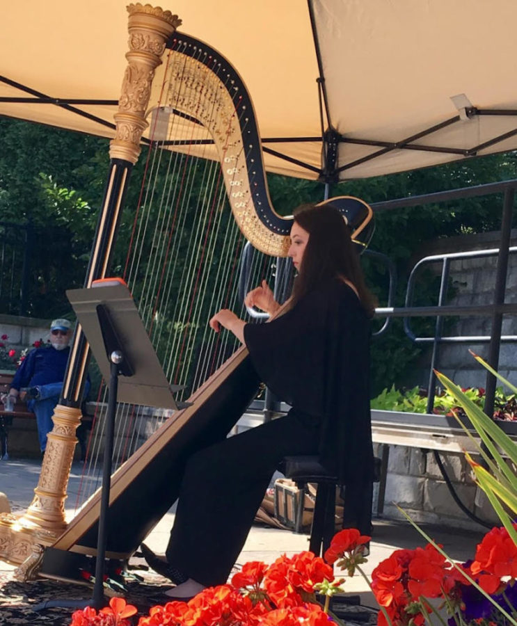 PLUCKING THE STRINGS: Catherine Ramsey (10) performs her musical skills in front of the community.