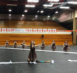 Winter guard closes successful season with increased weaponry skills