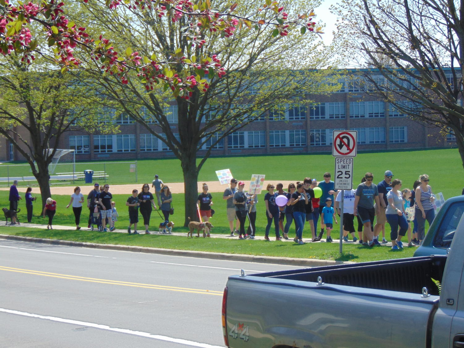 Marchers depart from Downers South HS and make way to McCollum Park