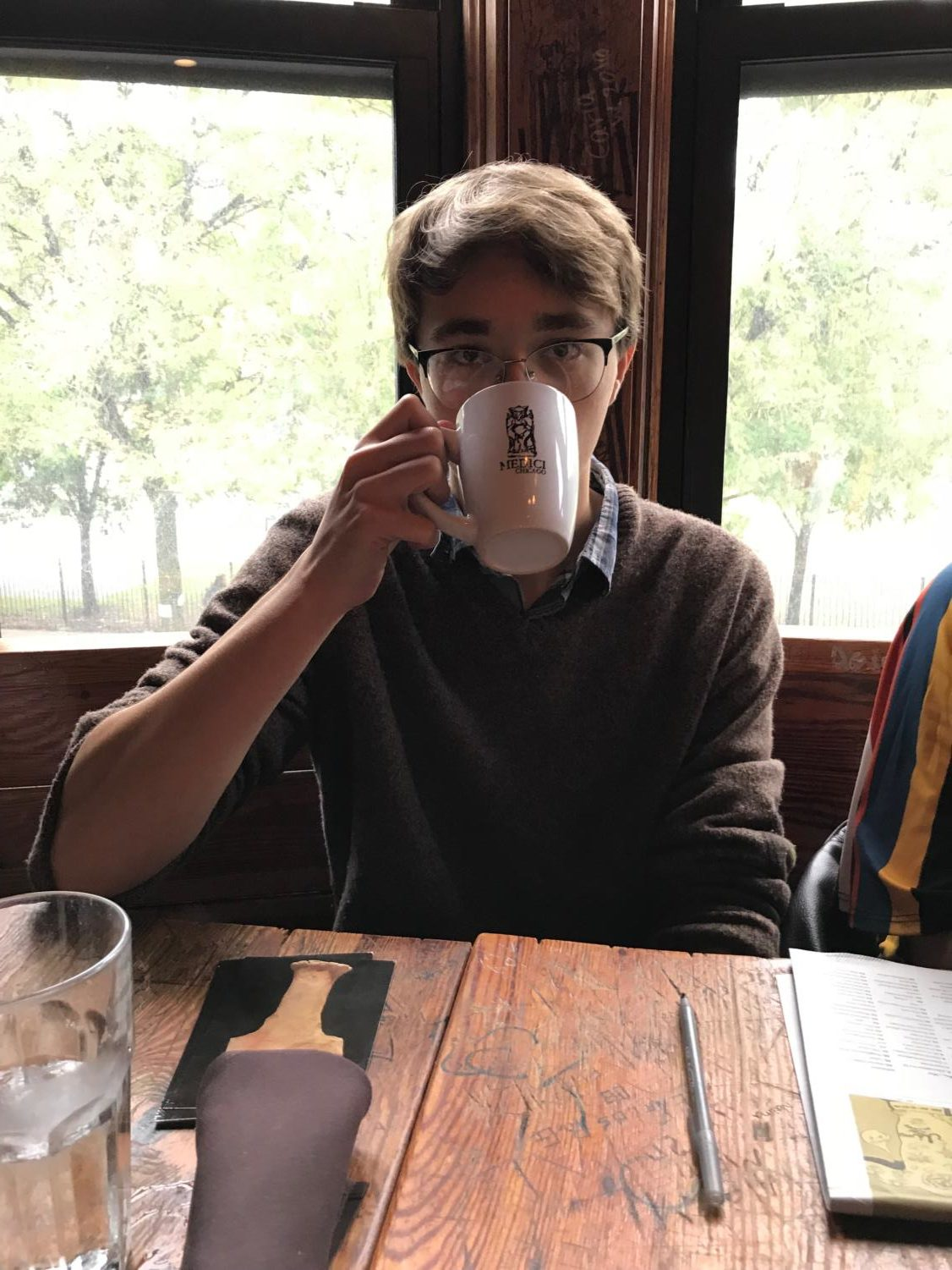 Coffee anyone? Omega editor Matt Troher enjoys a cup of his favorite beverage, coffee