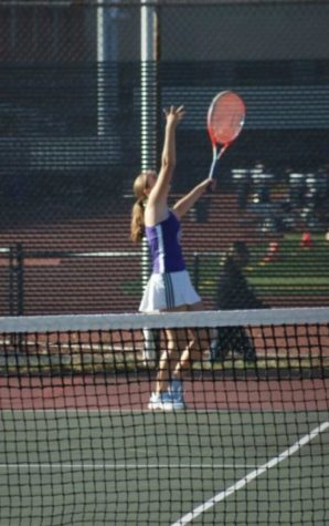 SMASHING SERVE: Kate Southworth (9) prepares for a serve.