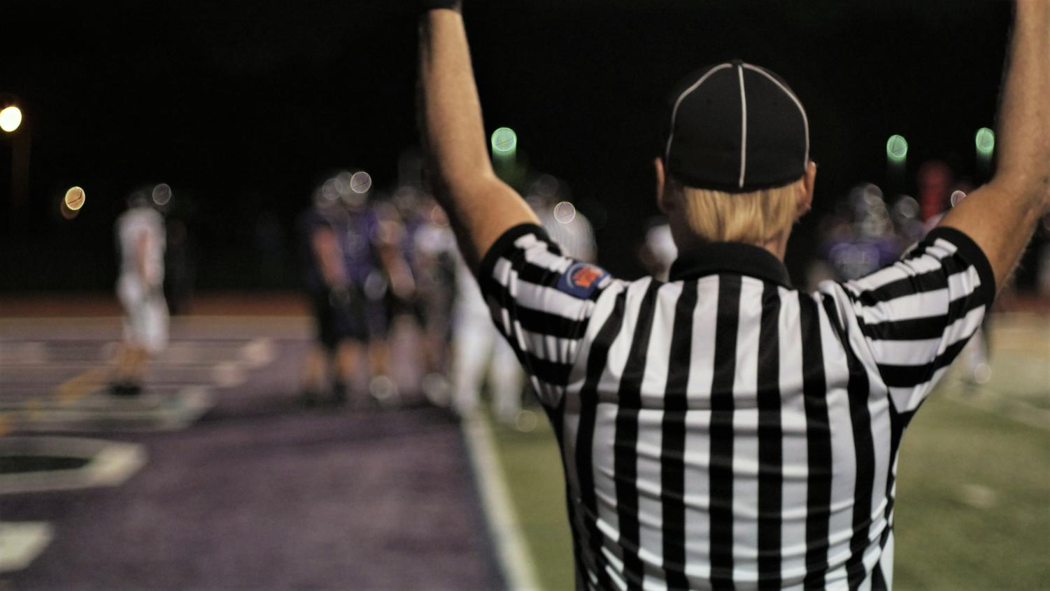 BLOWOUT: the referee signals for a score after a Drew Cassens rushing touchdown.