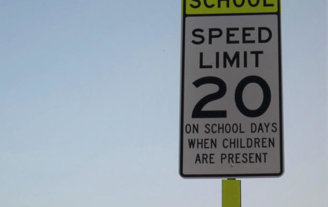 SCHOOL ZONE: A sign placed near the Main Street crossing warns of the speed limit change, from 25 miles per hour down to 20, in the upcoming area.
