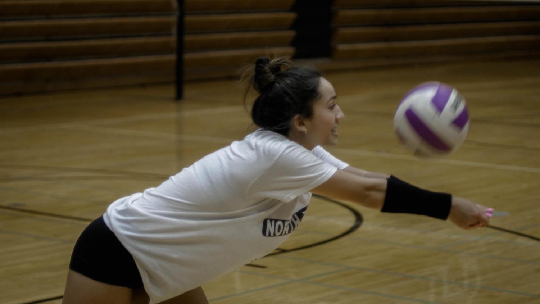 WORKING HARD: Maddi Cuchran (11) reaches to pass the ball in training.