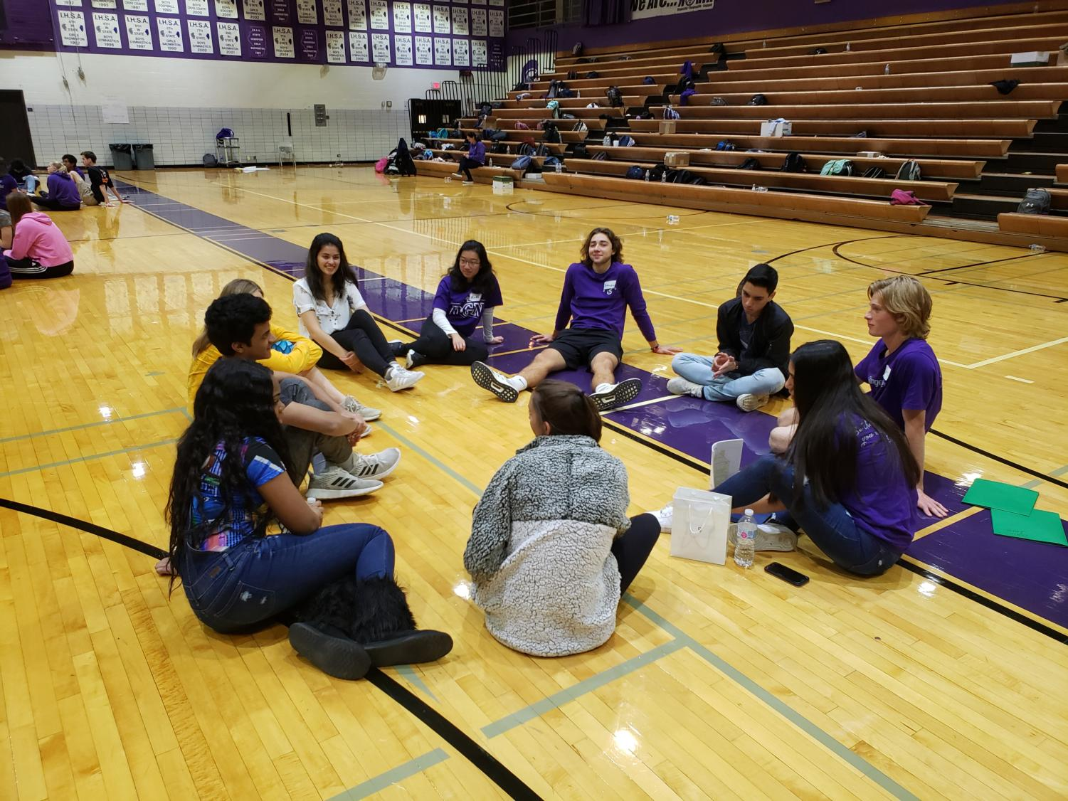 BUILDING EMPATHY: A small group gathers in a circle at the Changemaker Day Oct. 9 to share personal experiences with their classmates in order to build their leadership skills and become a DGN changemaker.