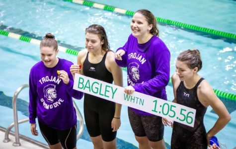 RECORD-BREAKER: Libby Benge (12) holds up the previous pool record for the 100-yard breaststroke, which she broke at the sectional meet Nov. 16.