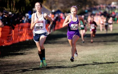 FINISH ON EMPTY: Melissa Jachim (11) kicks down Evanston Township's Hope Leman (11) in the final stretch at the IHSA state meet Nov. 9.