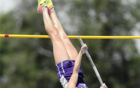 VAULTING: CP Breit (12) clears the bar at a track meet during the 2019 season. Breit will continue to pole vault at the University of Wisconsin Madison next year.
