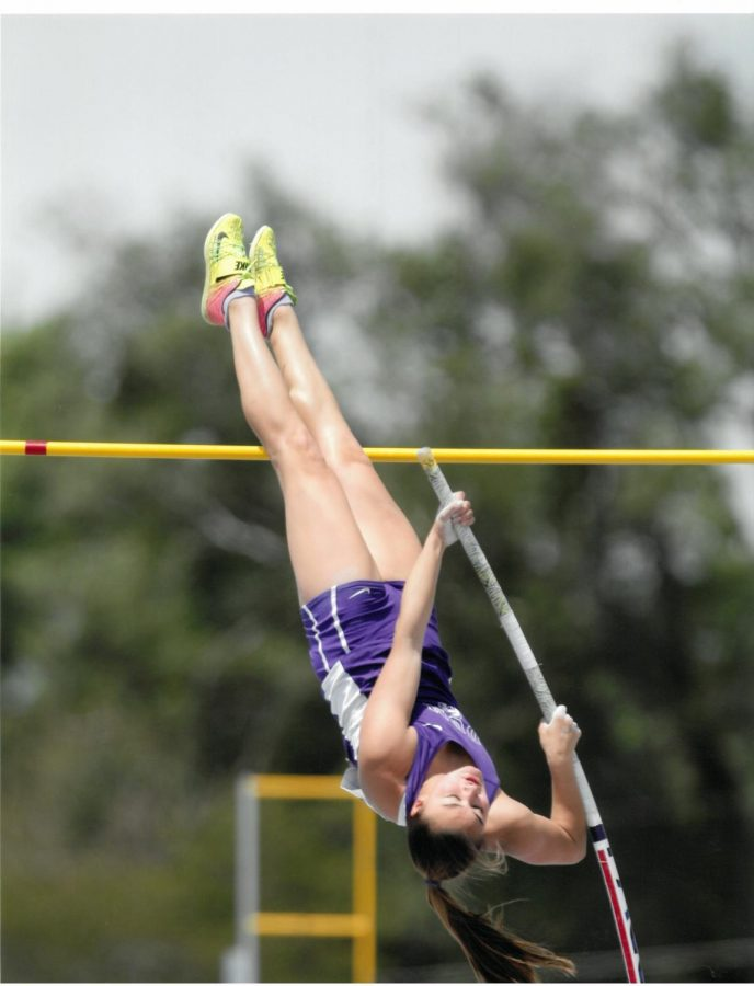 VAULTING%3A+CP+Breit+%2812%29+clears+the+bar+at+a+track+meet+during+the+2019+season.+Breit+will+continue+to+pole+vault+at+the+University+of+Wisconsin+Madison+next+year.+