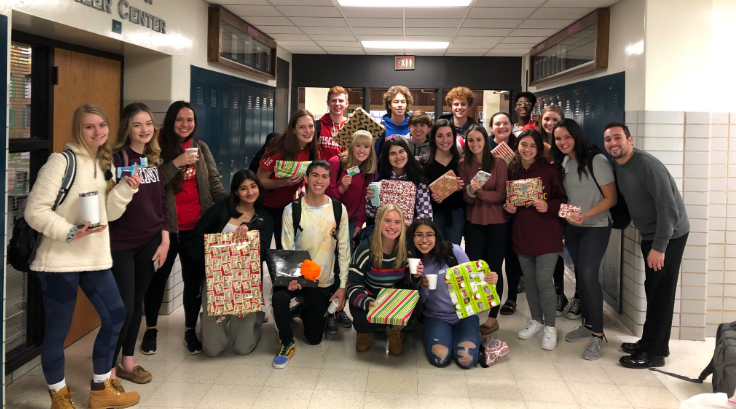 GIVE BACK: Mr. Bodenhiemer's 8th period class poses with donated gifts to Giving Tree