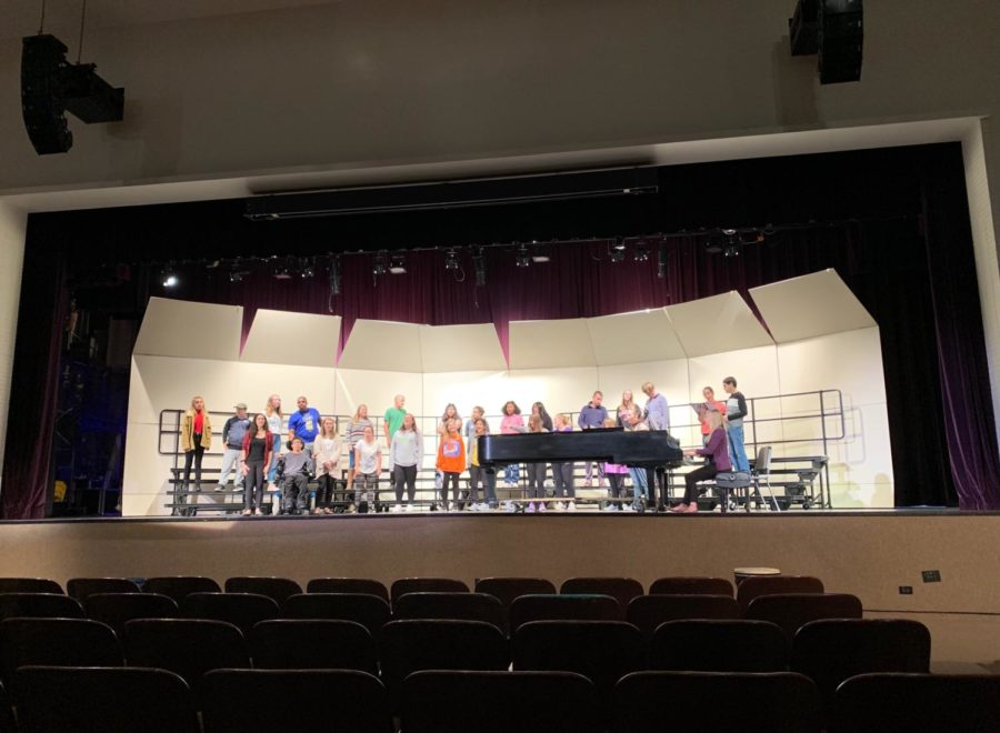 Slaying the stage: All-Access Choir performs in the auditorium during class to get a feel of the spotlight.