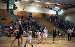 Girls' Basketball beats York on the road, ties for first in Conference