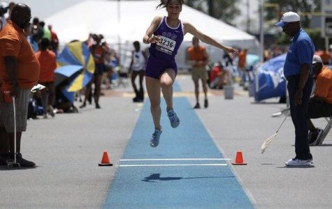HIGH STAKES: McKenna Cinotte (11) competes at the 2019 IHSA state meet. Like Cinotte, athletes lost the opportunity to compete