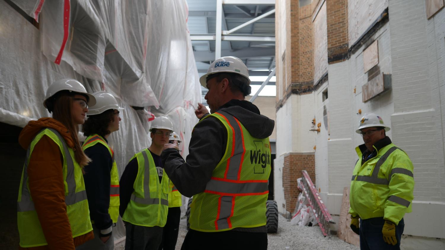Dr. Sorensen explains where a new door will be located to the Omega staff members.