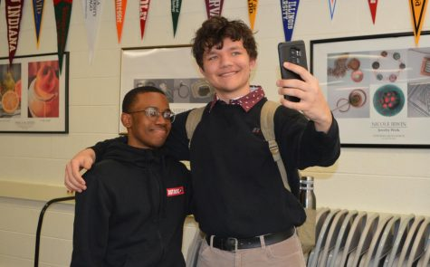 GETTING A PICTURE: Arthur Kot (right, 10, East Leyden) poses for a selfie with his partner, Quentin Mills (left, 10, DGN).