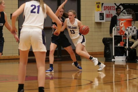 MAKING A MOVE: Maggie Fleming (09) drives against Nazareth. the Trojans beat the Roadrunners 45-31 to claim a Regional title.