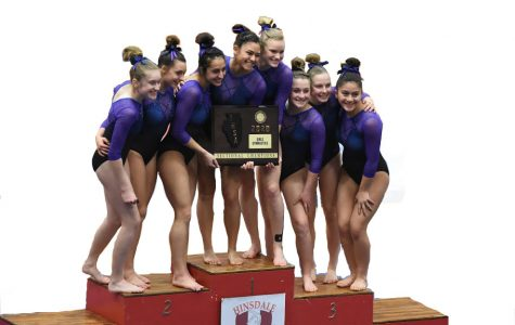 ONE TEAM ONE DREAM: The 'Trostangs' pose atop the podium following a first place finish at Sectionals Feb. 02.