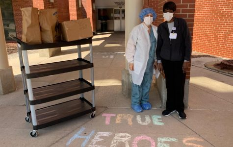 TRUE HEROES: front-line hospital workers pose in front of a donation from Feed the Frontline Chicago.