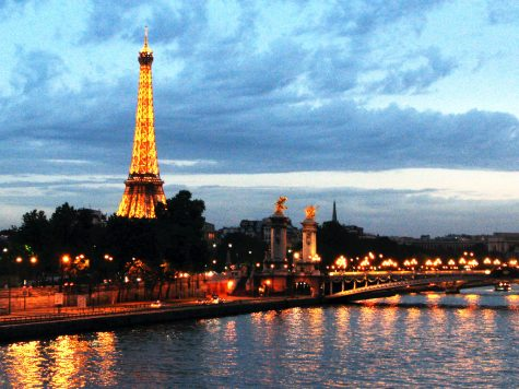 A view of the Eiffel Tower at night from the River Seine.