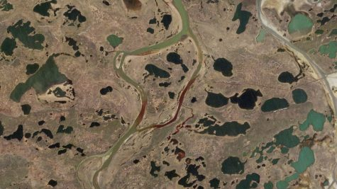 SEEPING IN: satellite imagery from May 31 shows oil spilled into rivers near Norilsk, Russia, coloring the water red.