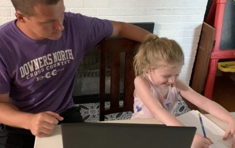 TEACHING FROM HOME: science teacher Bob Calder helps his daughter during remote learning.