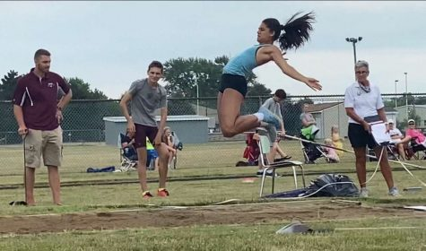 GOING FOR THE RECORD: McKenna Cinotte (12) competes in the triple jump at a July 25 meet.