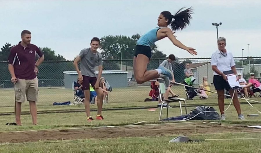GOING+FOR+THE+RECORD%3A+McKenna+Cinotte+%2812%29+competes+in+the+triple+jump+at+a+July+25+meet.