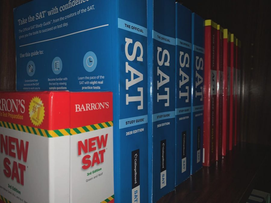 PRACTICE, PRACTICE, PRACTICE: a photo of SAT and ACT practice books, representing the only version of the tests that many students have been able to take in the last several months.