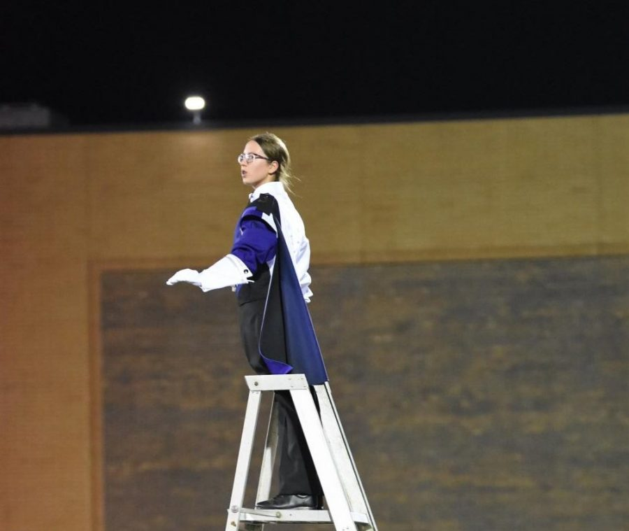 TOP OF THE LADDER: Drum Major Carissa Blumka (12) conducts for the marching band.