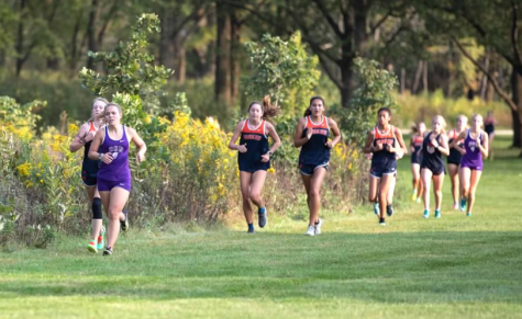 LEADER OF THE PACK: Rylan Gaspar (12) leads a group of runners at home dual meet versus Oak Park River Forest. Dual meets are the only regular season competitions permitted this season in order to comply with COVID-19 safety guidelines.