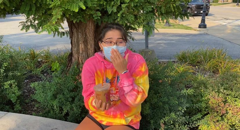 CAFFEINE ADDICT: Sports editor Vanessa Lopez enjoys an Iced Pumpkin Spice Latte from Dunkin