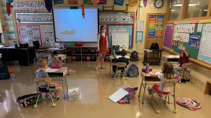 SOCIALLY DISTANCED WITH ELEMENTARY STUDENTS: Senior Julia Niemiec works with her first-grade students during a lesson.