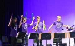 MIC DROP: Trojan Thunder throws their Boomwhackers after finishing their 2019 Talent Show performance.