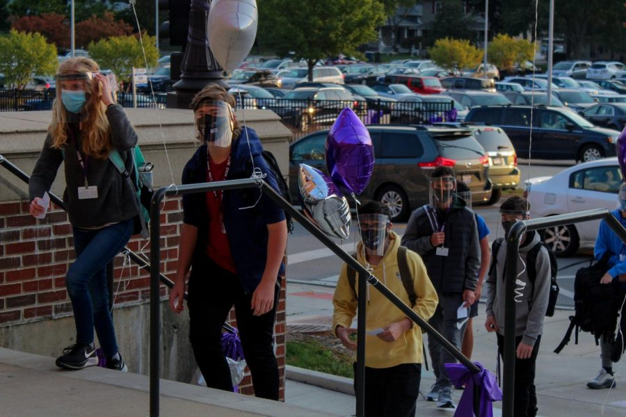 Masked and ready: Freshmen are welcomed into the building for their first day of in-person instruction on Oct. 6.