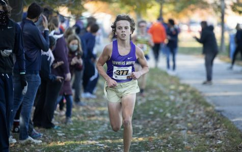 WALK IN THE PARK: Topher Ferris (10) keeps a powerful stride throughout his race