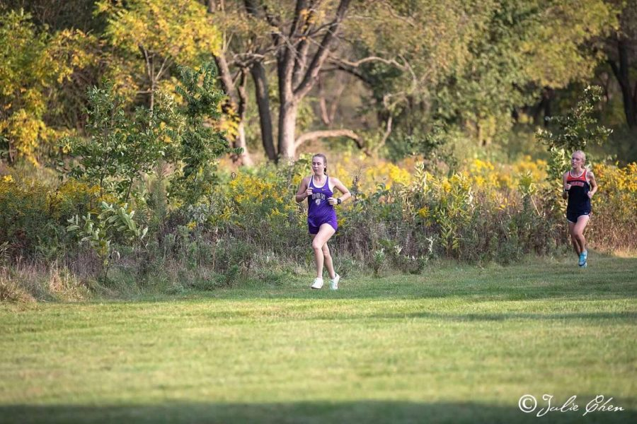 Sprinting towards success: Junior Elena Tomchek finishes in first place at a conference meet