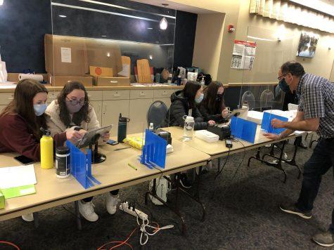 Student judges Gwen Casten and Alexa Hanson seen checking in a voter