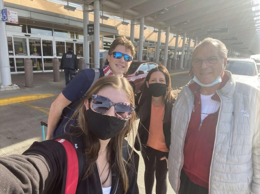 SAFE TRAVELS: Janicki snaps a selfie with her family at Midway Airport while they take precautions against COVID-19.