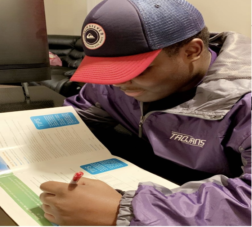Jordan Lewis works on his bible study