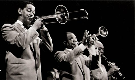 Louis Armstrong performs alongside Trummy Young and Edmund Hall