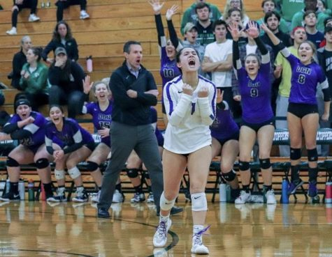 THE FEELING OF SUCCESS: Senior Maddi Cuchran leads teammates to victory
