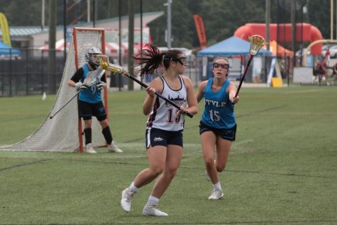ON THE ATTACK: Senior Madeline Schallmoser settles the ball before making a move on the cage at a tournament with her club team, Lakeshore Lacrosse.