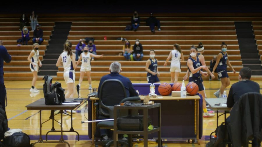 BEHIND THE SCENES: The capacity of the Purple Gym was restricted. Sideline benches were distanced, and each home athlete was allowed to bring 2 spectators.