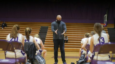 BRING IT IN (but not too close): Coach Bolt talks to a socially distant huddle. In the Purple Gym